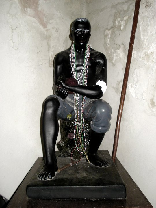 a statue of a seated older Black man